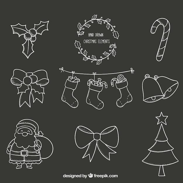 Hand drawn christmas elements on blackboard Free Vector