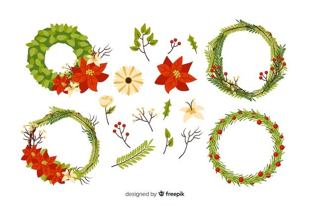 Ручной обращается рождественские цветы и коллекция венок Бесплатные векторы
