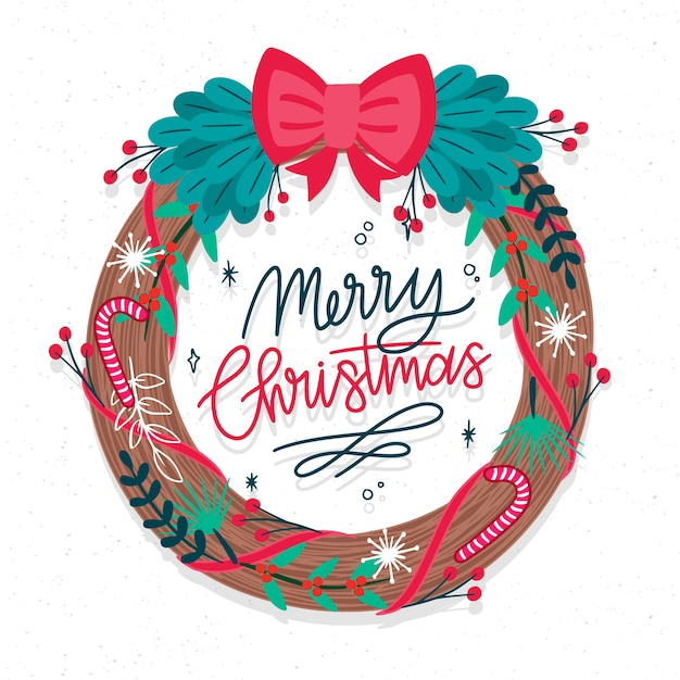 Hand drawn christmas wreath concept Free Vector