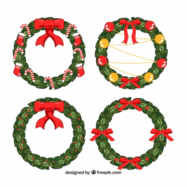 Hand drawn christmas wreaths decorated with red bows