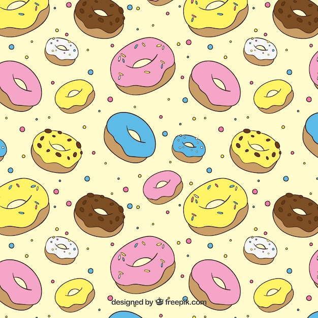 Hand drawn colored donuts pattern Free Vector
