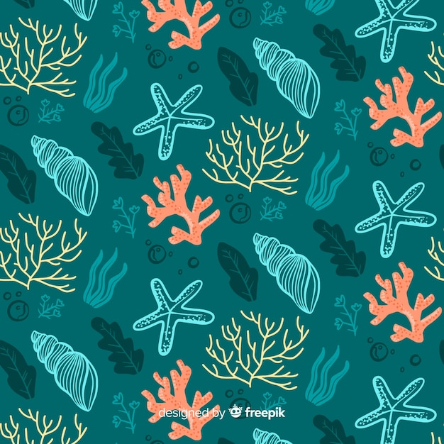 Hand drawn coral and shells pattern Free Vector