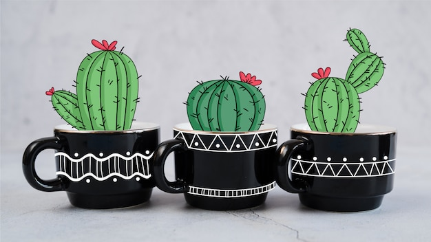 Hand drawn decorative cactus in several mugs Free Vector
