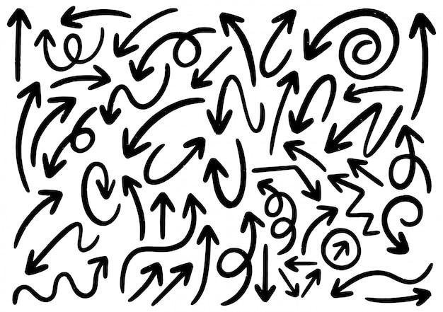 Рисованной каракули элементы дизайна. ручной обращается стрелки, рамки, границы, значки и символы. Premium векторы