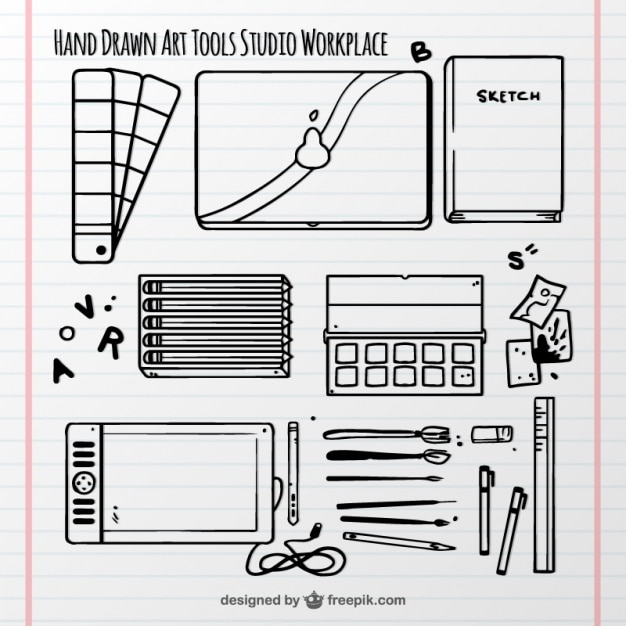 Hand-drawn elements art studio on a notepad Free Vector