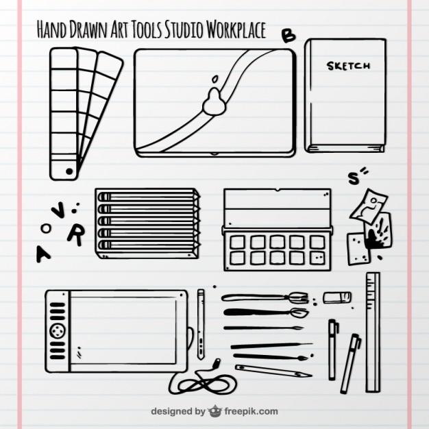 Нарисованные от руки элементы арт-студия на блокнотом Бесплатные векторы