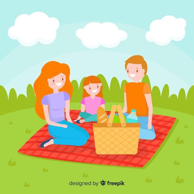 Hand drawn family having a picnic Free Vector