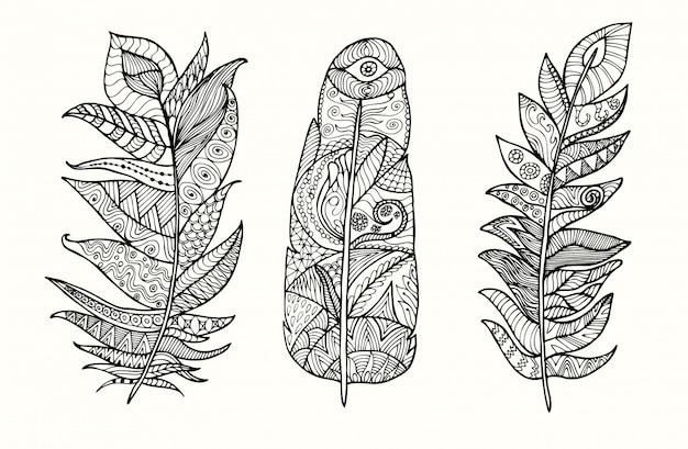 Hand drawn feather set with doodle, zentangle, floral, vintage elements. Premium Vector