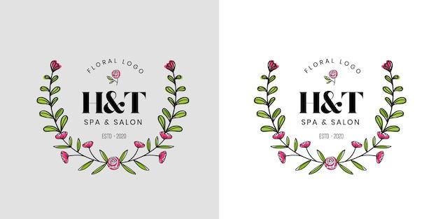花と葉と手描きのフェミニンな美しさの花のロゴ Premiumベクター