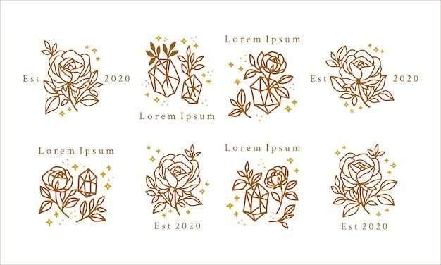 금 꽃, 결정 및 별을 가진 손으로 그린 여성 뷰티 로고 프리미엄 벡터