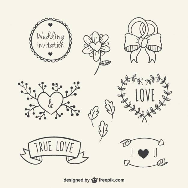 Hand drawn floral elements for wedding Free Vector