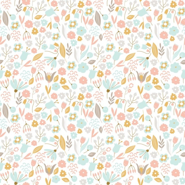 Hand drawn floral pattern in pastel colors Free Vector