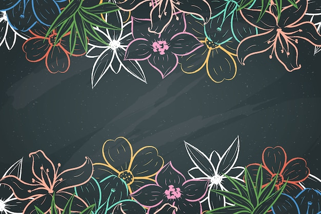 Hand-drawn flowers on blackboard background Free Vector