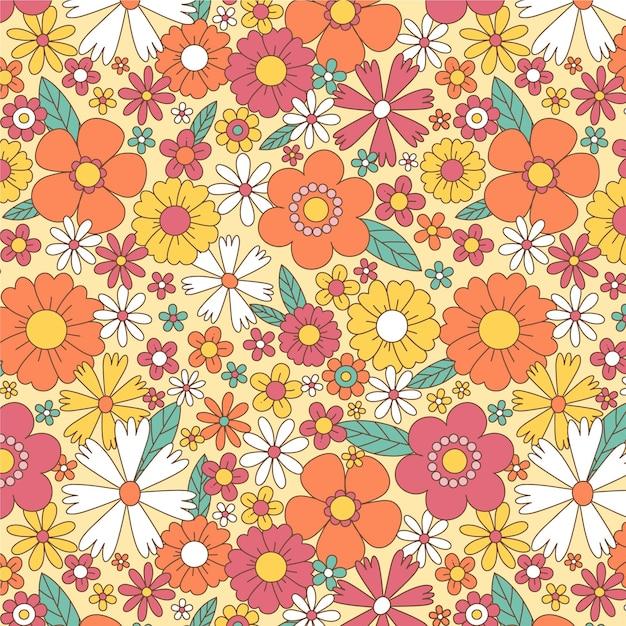 花と手描きのグルーヴィーなパターン 無料ベクター