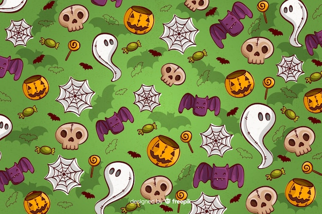 Hand drawn halloween background seamless pattern in green Free Vector
