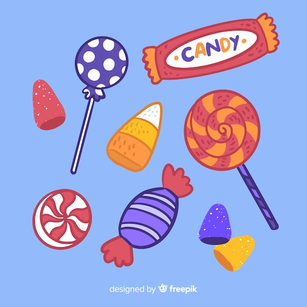 Hand drawn halloween candy collection on blue background Free Vector