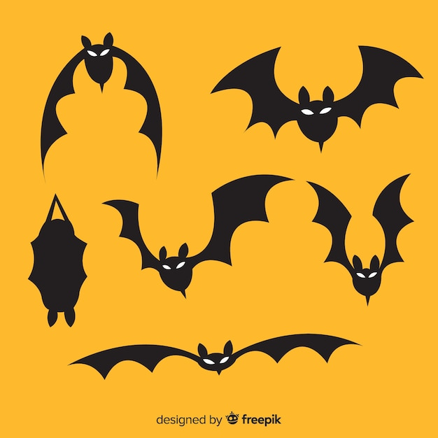 Hand drawn halloween flying bats Premium Vector