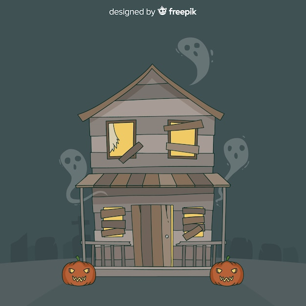Hand drawn halloween haunted house Free Vector