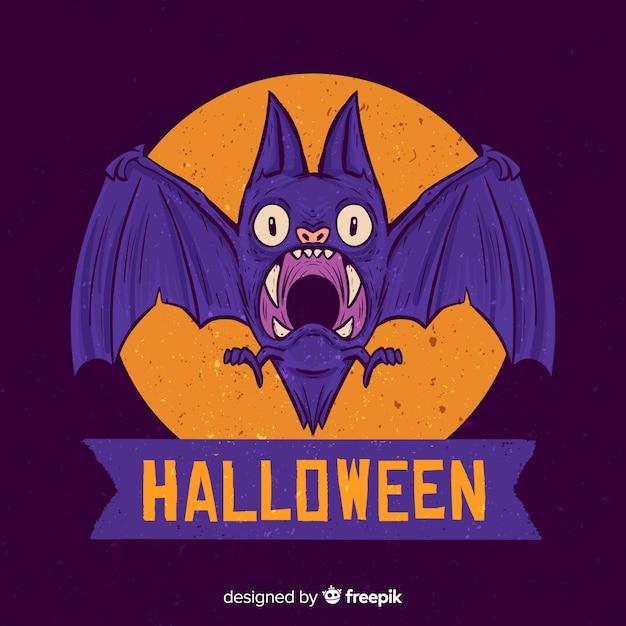 Hand drawn halloween scared purple bat Free Vector