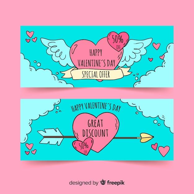 Hand drawn heart valentine's day banner Free Vector