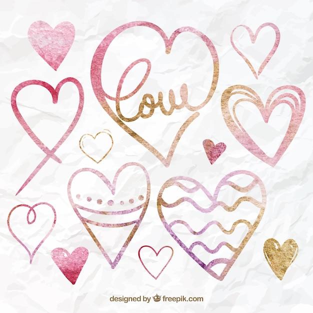 Hand drawn hearts decorative Free Vector