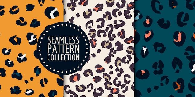 Hand-drawn leopard spots seamless pattern set Premium Vector