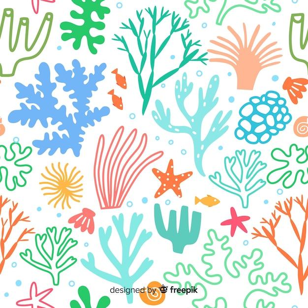 Ручной обращается пастельный цвет коралловый фон Бесплатные векторы