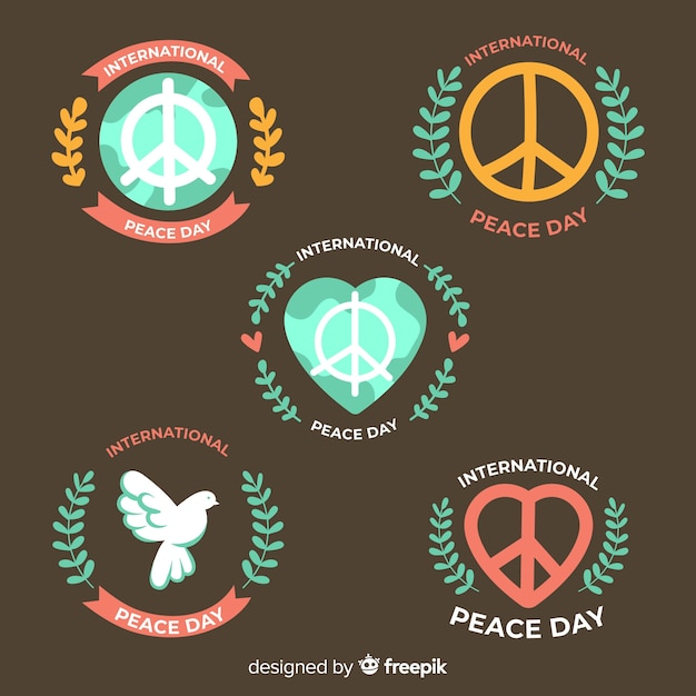 Hand drawn peace day badge collection Free Vector