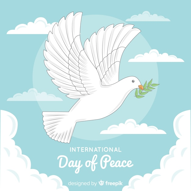 Hand drawn peace day with dove and olive leaf Free Vector