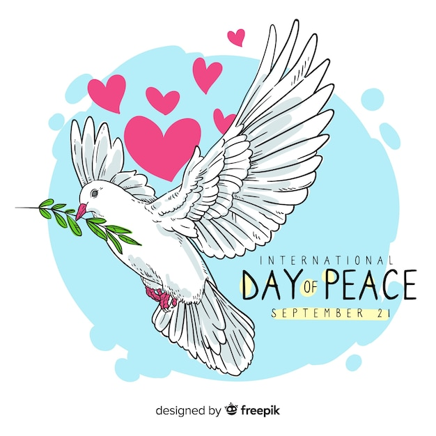 Hand drawn peace day with a dove Free Vector