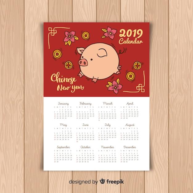 Hand drawn pig chinese new year calendar Free Vector