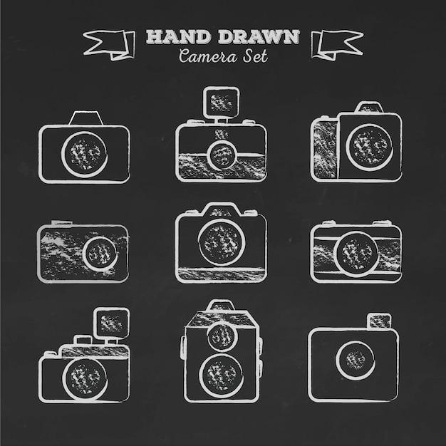 Hand drawn retro cameras on blackboard