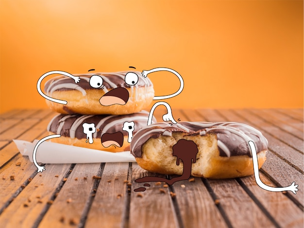 Hand drawn scared chocolate donuts Free Vector