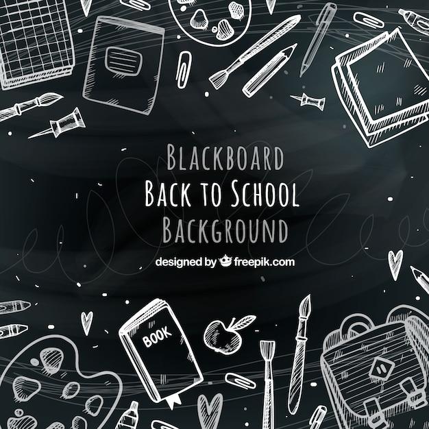Hand drawn school materials on blackboard Free Vector
