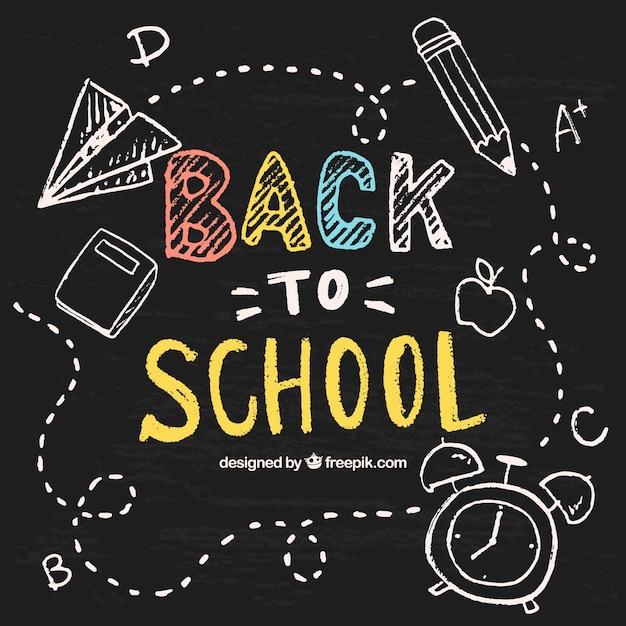 Hand drawn school objects on the blackboard