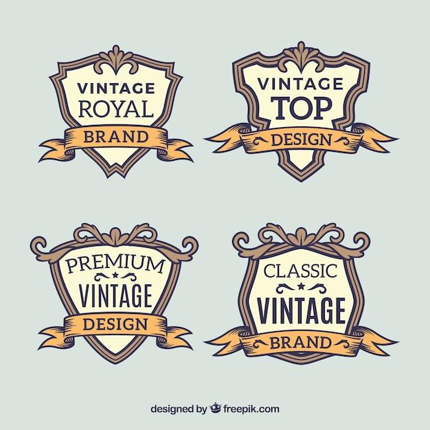 Hand drawn set of vintage badges Free Vector
