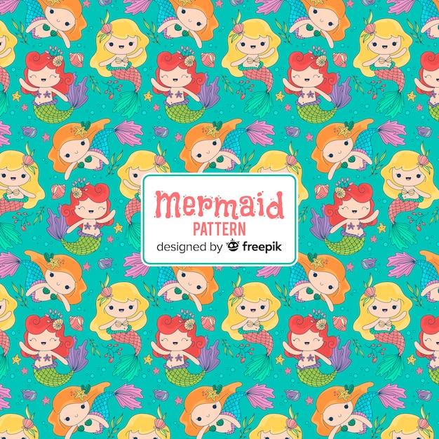 Hand drawn smiling mermaid pattern Free Vector