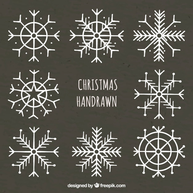 Hand drawn snowflakes on blackboard vector free download