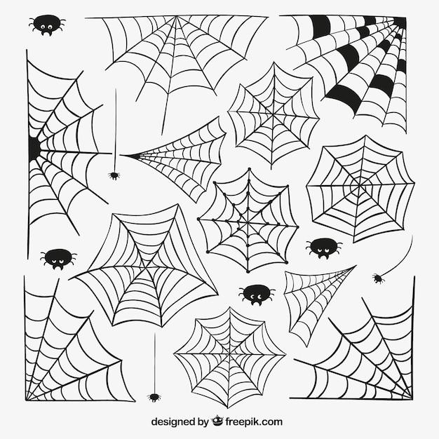 Hand drawn spider webs Free Vector