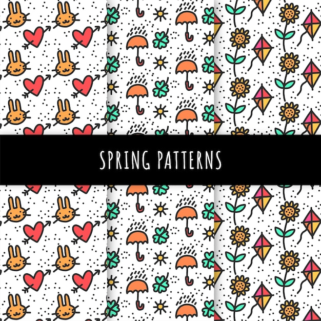 Hand drawn spring pattern collection with umbrellas and kites Free Vector