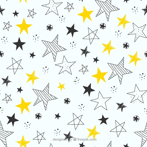 Hand drawn stars pattern background Free Vector