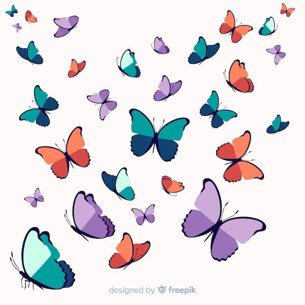 Sfondo di farfalla sciame disegnati a mano Vettore gratuito