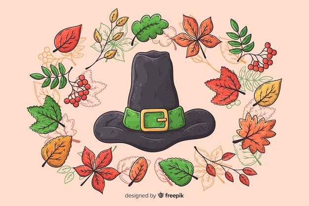 Hand drawn thanksgiving background with witch hat Free Vector