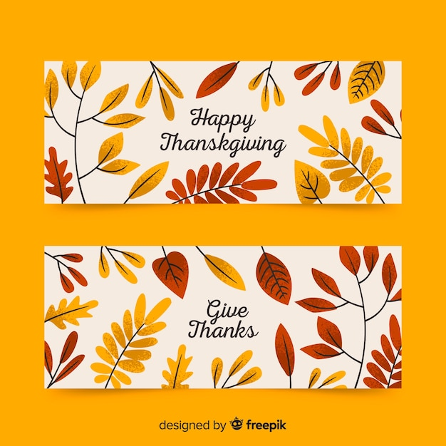 Hand drawn thanksgiving banners with dried leaves Free Vector