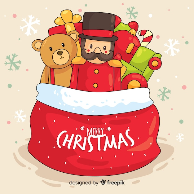Hand drawn toy bag christmas background Free Vector