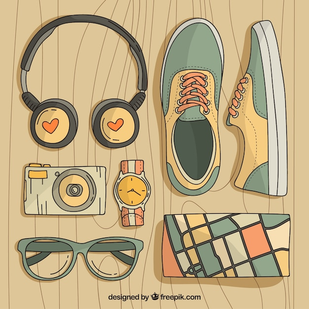 Hand drawn traveler elements collection Free Vector