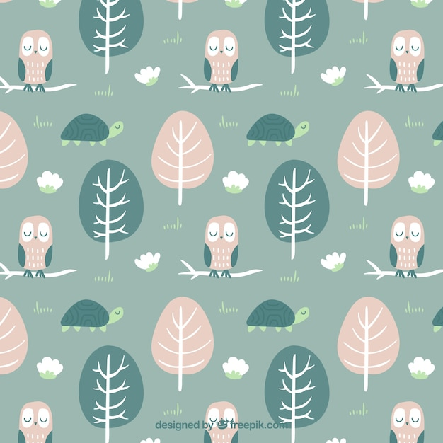 Hand drawn trees with lovely owl pattern Free Vector