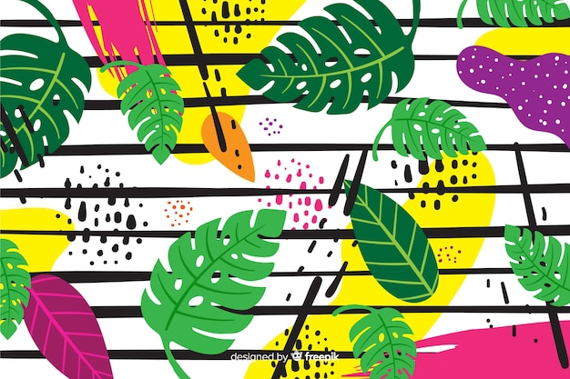 Hand drawn tropical leaves background Free Vector