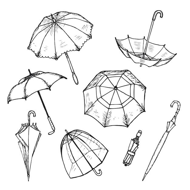 Set di ombrelli disegnati a mano Vettore gratuito