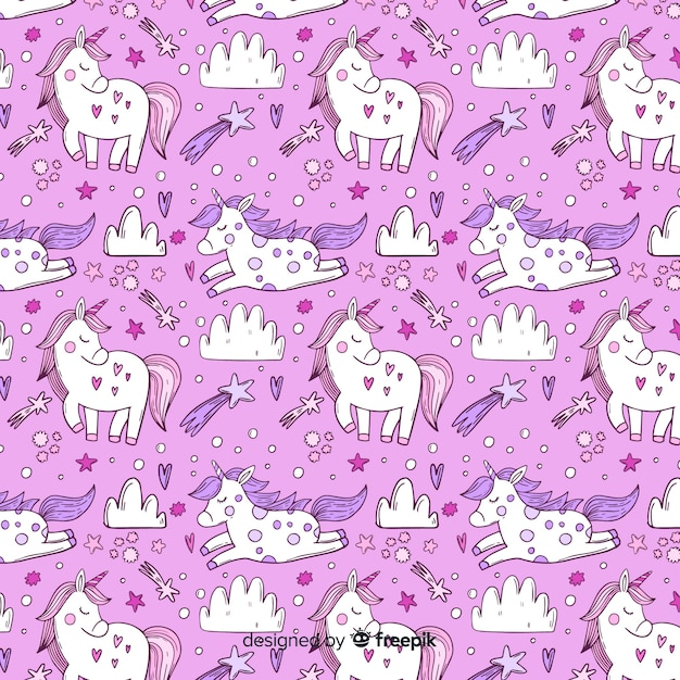 Hand drawn unicorn pattern background Free Vector